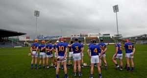 The Tipperary team stand for the national anthem before the start of the game against Cork. Photograph: James Crombie/Inpho