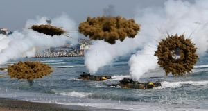 Amphibious assault vehicles of the South Korean Marine Corps launch  smoke bombs as they move to land on shore during a joint US-South Korea military drill in Pohang today. Photograph: Kim Hong-Ji/Reuters