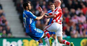 Ahmed Elmohamady of Hull City challenges Stephen Ireland of Stoke City during the  Premier League match  at the Britannia Stadium. Photograph: Paul Thomas/Getty Images