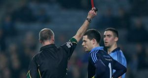Referee Cormac Reilly shows a straight red card to Dublin captain and goalkeeper Stephen Cluxton at Croke Park. Photo: Donall Farmer/Inpho