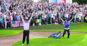 Darren Clarke celebrates after making a 110 ft putt on the 12th green as he plays against Zach Johnson of the United States in the singles session on the third and final day of the 2006 Ryder Cup at the K Club in Straffan, Co Kildare. Photograph: Adrian Dennis/AFP/Getty Images
