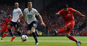 Liverpool striker  Luis Suarez   scores against Tottenham Hotspur during their  Premier League  match at Anfield. Photograph:  Photograph: Phil Noble/Reuters