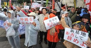 Up in arms: a rally denouncing the relocation of a US military base in Okinawa recently. Photograph: Jiji Press/AFP/Getty Images)