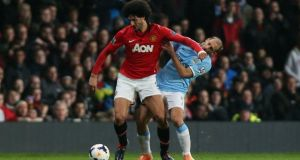 Manchester United's Marouane Fellaini elbows  Manchester City's Pablo Zabaleta  during the  Premier League match at Old Trafford.  Photograph: Peter Byrne/PA