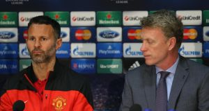 Manchester United  manager David Moyes (right) alongside midfielder  Ryan Giggs  during a press conference at Old Trafford. Photograph: Alex Livesey/Getty Images