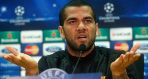 Barcelona's Dani Alves at yesterday's press conference where he defended team-mate and compatriot Neymar.