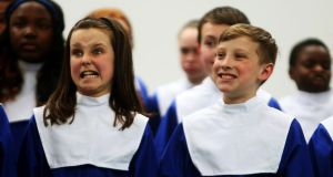 Pupils from St. Molaga's N.S., Balbriggan Co. Dublin, Caitlin Tiernan and Tomas Baxter  pull faces as part of their warm up at Feis Ceoil 2014. Photograph: PA