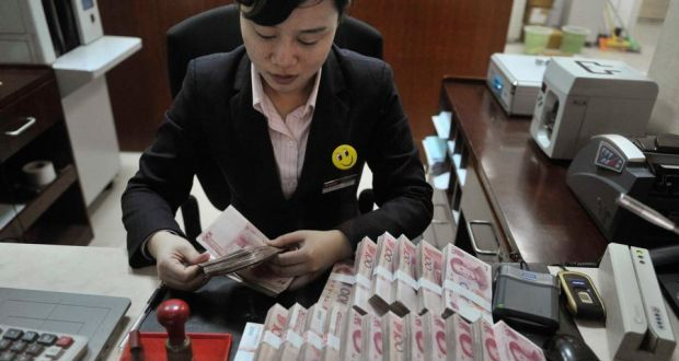 A clerk at a branch of China Merchants Bank, in Hefei, Anhui: China will not have a financial meltdown, but reform and rebalancing are essential. Photograph: Reuters