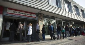 Jobseekers enter an employment office after opening in Madrid.  Spain's unemployment rate stood at 26 per cent in the last quarter of 2013. Photograph: Angel Navarrete/Bloomberg