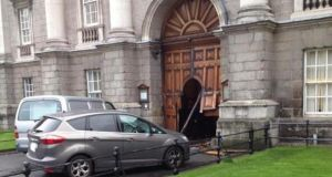The damaged front gates at Trinity Collge Dublin. Photograph: Gary O'Sullivan