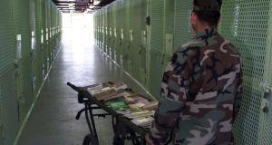 A librarian pushes a book cart in Guantanamo Bay, Cuba. Photograph: Getty Image