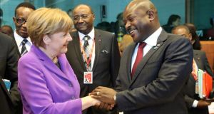 German chancellor Angela Merkel and Burundian president Pierre Nkurunziza during the fourth EU-Africa summit of heads of state at the European Council headquarters in Brussels yesterday. Photograph: Olivier Hoslet/EPA