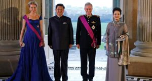 Queen Mathilde of Belgium, China's President Xi Jinping, King Philippe of Belgium and Mr Xi's wife, Peng Liyuan, prior to a state dinner at Laeken Royal Palace in Brussels. Photograph: Yves Herman/EPA