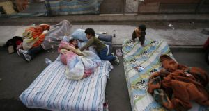 Children sleep in the open in an elevated area in the city of Iquique, northern Chile, in expectation of further tremors this week. Photograph: Felipe Trueba/EPA