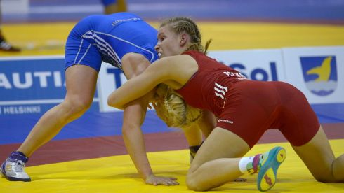 Aline Focken (in red) of Germany and Anna Jenny Eva Maria Fransson of Sweden grapple during their women's 69kg freestyle wrestling match.  Photograph: Markku Ulander/Lehtikuva/Reuters