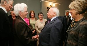 President Michael D Higgins and his wife Sabina, right, meet the Irish Elderly Advice Group at London Irish Centre in 2012. Photograph: Joanne O'Brien