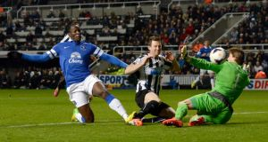 Everton's Romelu Lukaku (left) scores past Newcastle United's goalkeeper Tim Krull at St James's Park. Photograph: Nigel Roddis / Reuters