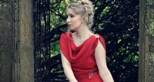 Felicity wears a red tweed dress, €455. Photograph: Michael Mac Sweeney/Provision