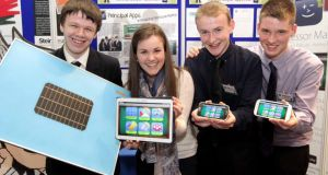 Joshua Dargan Hayes, from St Gerard's College, Bray, Co Wicklow displays his Connect Shade product while Fiona Hogan, Ian Moloney and Maurice Lynch from Coláiste Chiaráin, Croom, Co Limerick, show their app Professor Maths