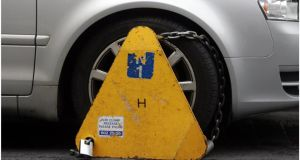 Clamping company DCPS was set a target by Dublin City Council to clamp 60,000 vehicles a year. Photograph: Bryan O'Brien