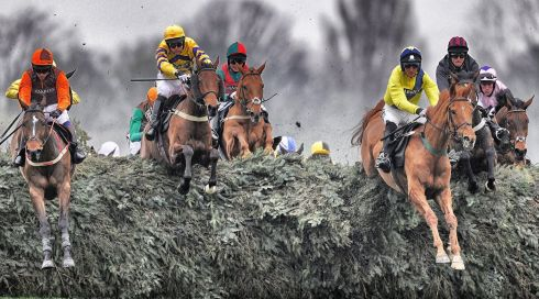 Sam Waley-Cohen riding Warne (left) clears the Chair on their way to winning The Crabbies Supporting The Hillsborough Families Fox Hunters' Steeple Chase at Aintree. Photograph: Alan Crowhurst/Getty Images