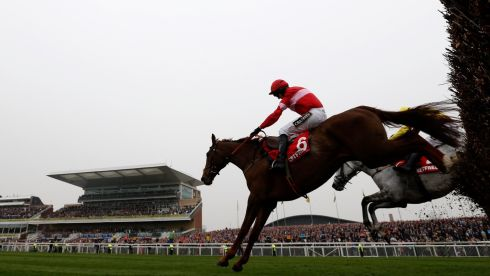 Silviniaco Conti, ridden by Noel Fehily, on the  way to winning the Betfred Bowl Steeplechase. Photograph: Russell Cheyne/Reuters