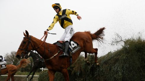 Orfeo Conti, ridden by Mr O Wedmore, jumps the Open Ditch in the Supporting The Hillsborough Families Fox Hunters' Steeple Chase.  Photograph: Russell Cheyne/Reuters