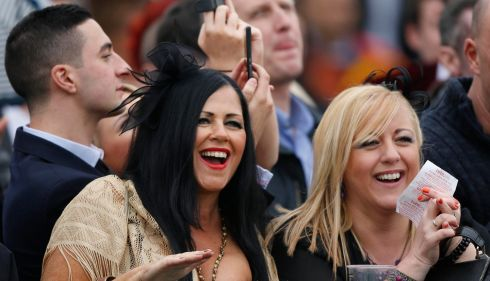 Women with fancy headgear, not hats, at Aintree. Photograph: Russell Cheyne/Reuters