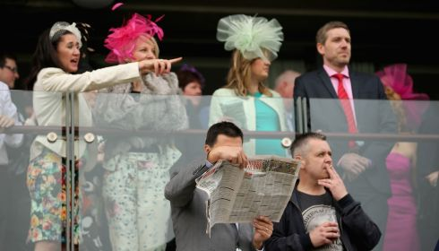 Racegoers cheer on their bets on Aintree opening day. Photograph: Christopher Furlong/Getty Images