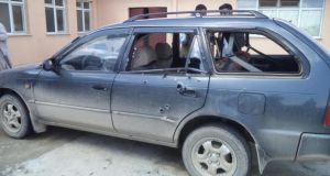 A bullet-ridden vehicle that was transporting Associated Press journalists Anja Niedringhaus, a German photographer and Kathy Gannon, a Canadian reporter, in Khost, Afghanistan when a policeman opened fire while they were sitting in their car. Photograph:  EPA/AHMADULLAH AHMADI