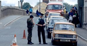 Troubled times: an RUC and British army checkpoint in Strabane, in 1978. It was among the most bombed towns in the North. Photograph: Alain le Garsmeur/Getty