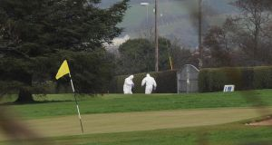Investigations: a forensics team at Ballycolman Road beside the third green at Strabane Golf Club, where an explosive device was discovered on Monday. Photograph: Trevor McBride
