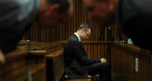 Oscar Pistorius   in the dock inside court in Pretoria. The murder trial will resume on Monday.  Photograph: Werner Beukes/AP
