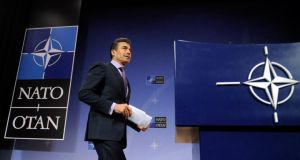 Nato secretary general Anders Fogh Rasmussen addresses a news conference  in Brussels on Wednesday.