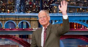 David Letterman waves to his audience after announcing that he intends to retire in 2015. Photograph: Jeffrey Neira/CBS
