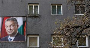 An election poster of Hungarian prime minister Viktor Orban  on a residential building in Budapest. Hungarians vote in a parliamentary election  today  that is set to return Mr Orban into power for another four years. Photograph: Bernadette   Szabo/Reuters