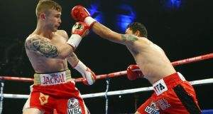 Carl Frampton (left) in action against Hugo Cazares in Belfast on Friday night. Photograph: Inpho