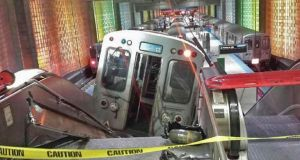 A derailed commuter train rests on an escalator at O'Hare international airport in Chicago March 24th, 2014. Thirty-two people were injured after a Chicago Transit Authority train derailed and hit a platform at O'Hare International Airport early on Monday. Photograph: Reuters