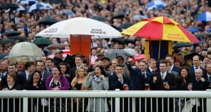 Punters cheer on their horses during the first race at Aintree. Photo: Laurence Griffiths/Getty Images