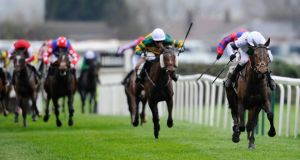 Pineau De Re goes clear to  win the Grand National Steeple at Aintree. Photograph: Alan Crowhurst/Getty Images