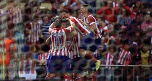 Atletico Madrid's players celebrate the opening goal against Villarreal. Photograph: EPA