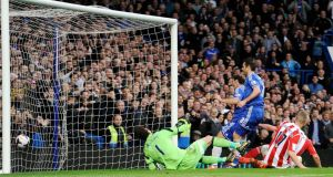 Frank Lampard  scores Chelsea's second goal against Stoke City. Photograph: EPA