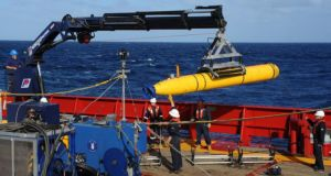 A handout picture  showing the Artemis autonomous underwater vehicle  on board the Australian Defense Vessel Ocean Shield. The instrument could help locate the flight recorder of the missing Malaysia Airlines plan and was deployed at one of the search areas today. Photograph: EPA