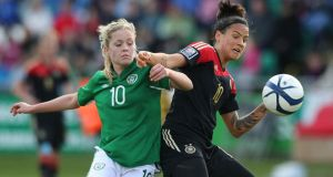 Denise O'Sullivan of Ireland is challenging Dzsenifer Marozsan of Germany   at Tallaght Stadium. Photograph:  Lorraine O'Sullivan/Bongarts/Getty Images