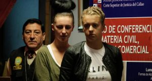 Michaella McCollum Connolly (left) and Melissa Reid, are escorted by police as they enter the Justice Court of Callao last August. Photograph: Mariana Baz/Reuters