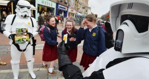 Loreto students Sarah Murray, Caoimhe Stewart and Lois Kelleher encounter members of the 501st Legion fundraising for the Irish Cancer Society during the recent annual Daffodil Day raiser, in  Dublin. Photograph: Alan Betson/The Irish Times