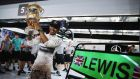 Lewis Hamilton of Great Britain and Mercedes GP celebrates with team mates in the pitlane after winning the Bahrain Formula One Grand Prix. Photograph:  Mark Thompson/Getty Images