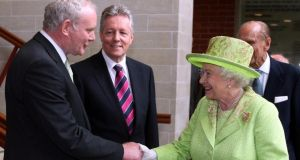 Martin McGuinness shakes hands with Queen Elizabeth  in Belfast in 2012. Photograph: Paul Faith/PA
