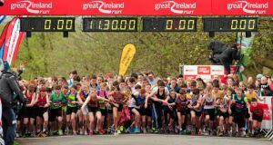 The start of the Junior Great Ireland Run, during the Spar Great Ireland Run 2014. Phoenix Park, Dublin. Photograph: Tomás Greally/Sportsfile