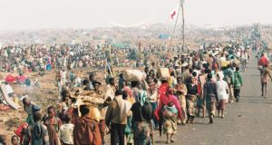 Refugees entering and leaving the emergency camps on the Goma road to the Congo from Rwanda, June, 1994. Photograph:  Liam Burke/Press 22/Concern